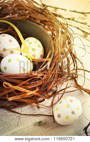 Composition With Easter Eggs In Nest, On Wooden Batskground, Tin