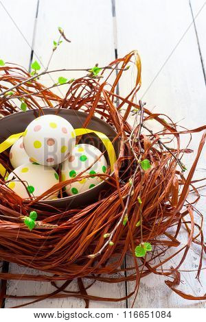 Composition With Easter Eggs And Ribbons  In Nest, On White Back