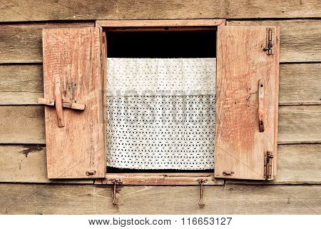 Wooden window at ancient building
