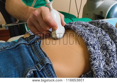 Doctor analyzing boy patient with abdomen ultrasound