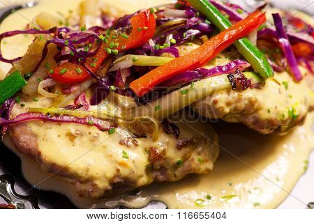 Russian fillet with vegetables and sauce.