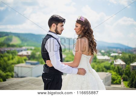 The Groom With The Bride On The Rooftop