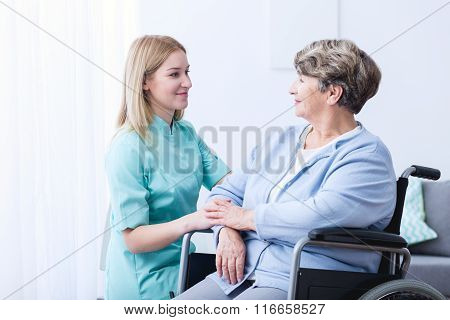 Nurse Caring About Elder Woman