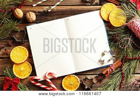 Christmas Tree Branch With Dried Oranges, Cinnamon And Anise Star On Wooden Table