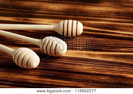 Wooden Honey Dipper On A Wooden Table