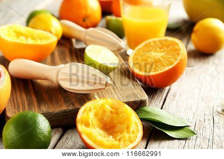 Wooden Juicer And Orange On A Wooden Table
