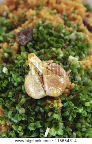 Head Of Garlic And Green Onion In A Pilaf - Food