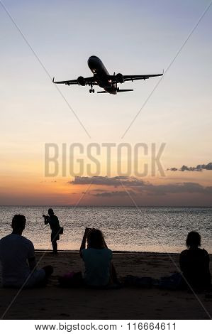 People With Plane And Color Of Sunset In Twilight