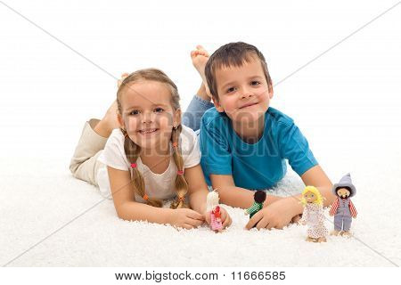 Happy Kids Boy And Girl Playing On The Floor