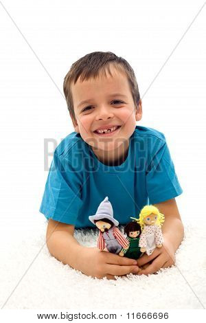Happy Kid Grinning With Missing Tooth Playing On The Floor