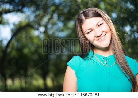 Young beautiful happy business woman in green shirt outdoors