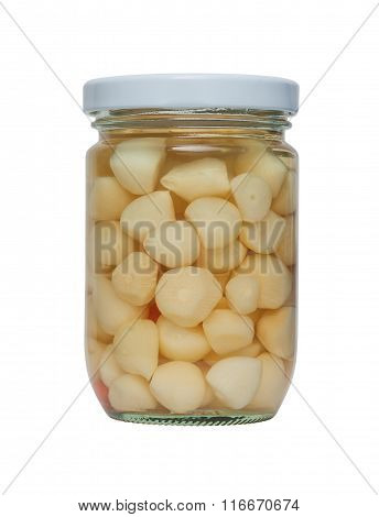 Pickled Garlic In A Glass Jar.
