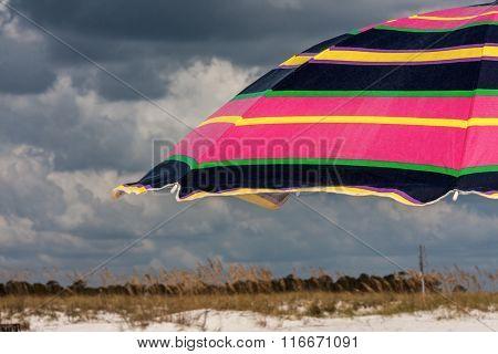Brightly Striped Beach Umbrella