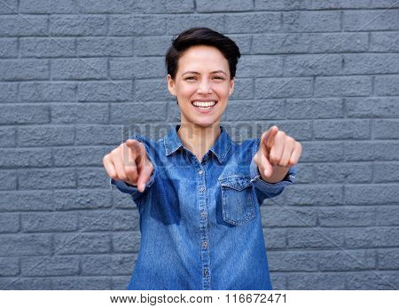 Smiling Young Woman Pointing Fingers
