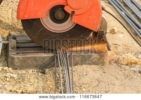 Worker Cutting Steel For Construction Job