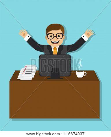 joyful businessman sitting behind a desk