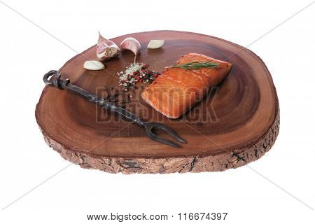 breakfast delicious portion of fresh roast salmon fillet dry spices garlic and rosemary wooden plate with black forged handmade fork healthy food diet cooking concept background empty space for text