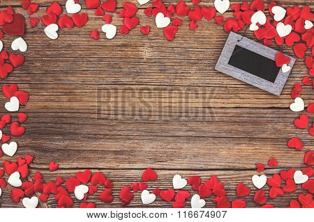 Valentines Day Background. Red And White Hearts Over Wooden Background. Toned, Soft Focus.