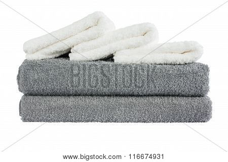 Stack Of Grey And White Bath Towels. Isolated Over White Background