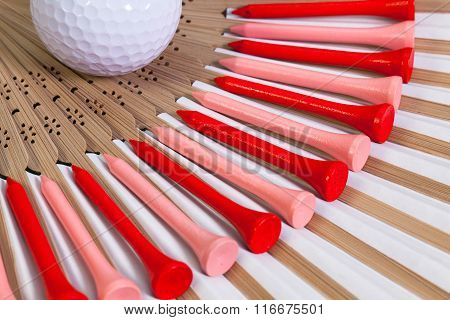 Typical Japanese hand fan made of bamboo and golf tees.