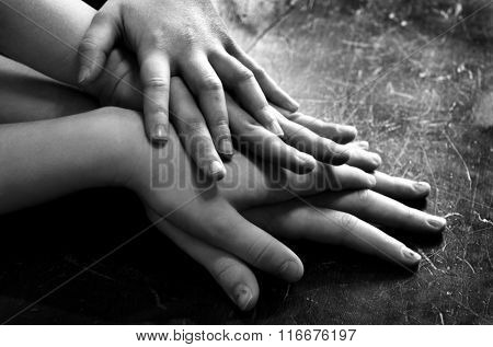 Several children hands on top of each other stacked up love and family group