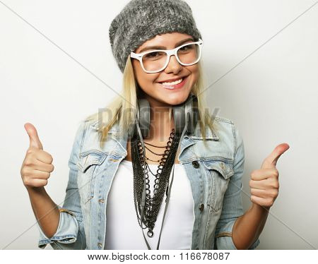 Happy woman giving thumb up