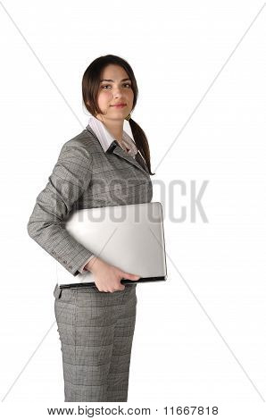 The Young Business Lady With The Laptop Under The Arm