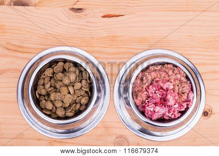 Choice Of Raw Meat Or Pellets Dog Food In Bowl