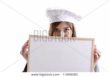 Young Female Cook Hiding Behind An Ad Board