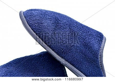 closeup of a pair of warm slippers on a white background
