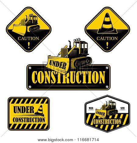 Set of under construction emblems, labels and designed elements