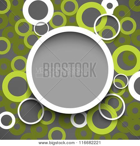 round white round frame with overlapping green circles on gray background