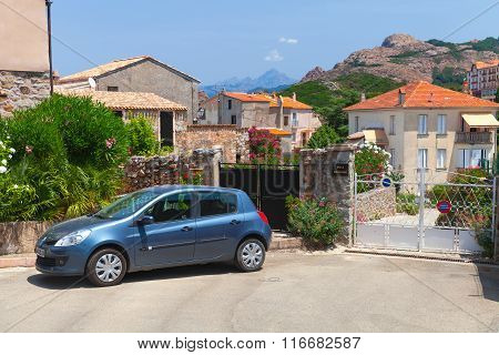 Corsica Island, Small Town Street View With Parked Car