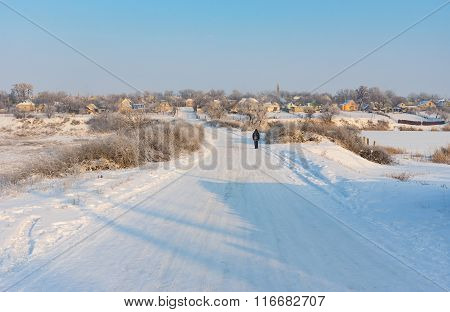 Landscape with winter street in urban-type settlement
