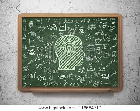 Finance concept: Head With Light Bulb on School Board background