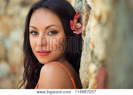 Portrait Of Beautiful Dark-haired Smiling Girl Against The Backdrop Of Medieval Stone Buildings In T