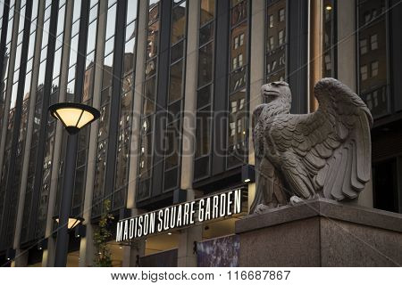 NEW YORK - NOV 25 2015: The large stone eagle sculpture outside the 7th Avenue entrance to Madison Square Garden sports arena in Manhattan. NY Penn Station is located underneath the arena.