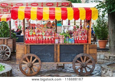 Lviv - Jule 05 2013: Candy Shop On Wooden Cart For Lollipops Sale In The Tourist Part Of Old City,