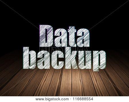 Information concept: Data Backup in grunge dark room