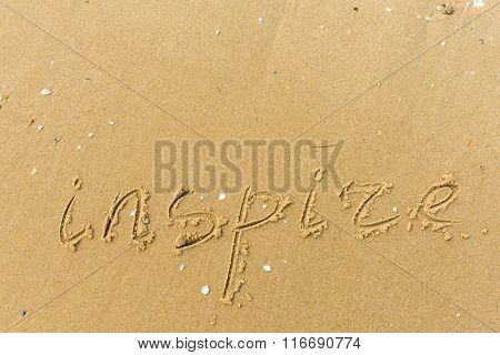 Inspire Written On The Beach Sand