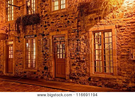 Quebec City Quebec Canada - Sept. 8 2015: Night brings a romantic character to the old stone buildings of historic Quebec City. Founded in 1608 Quebec remains a walled fortress and a UNESCO World Heritage Site.