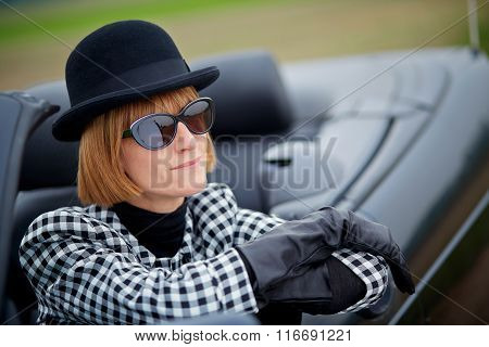 40S Woman With Sun glasses In A Convertible