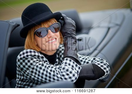 Stylish 40S Woman With New Convertible