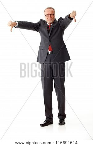 Mature Business Man With Thumbs Down, Angrily