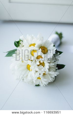 Wedding bouquet of camomile on a white background