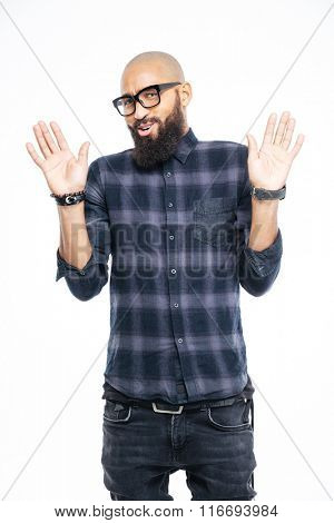 Afro american man showing stop sign with palms isolated on a white background