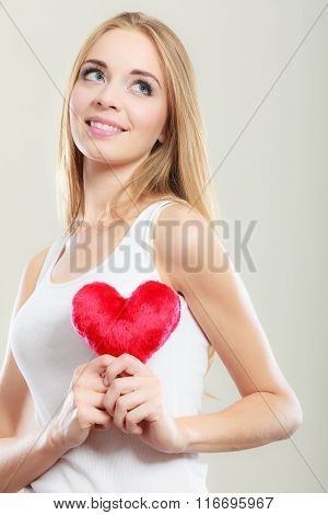 Smiling Woman Holding Red Heart Love Symbol