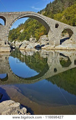 Reflection of Devil's Bridge in Arda river, Kardzhali Region, Bulgaria