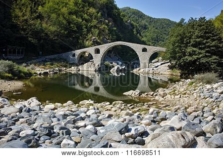 Reflection of Devil's Bridge and Rhodopes mountain in Arda river, Bulgaria