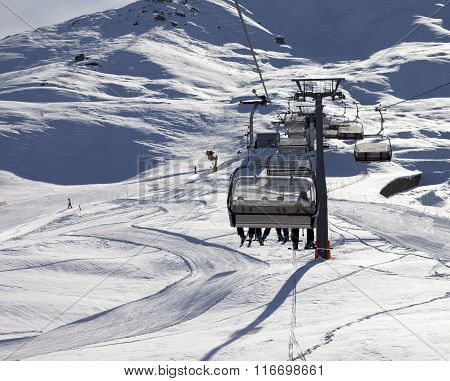 Chair-lift And Ski Slope At Sun Evening